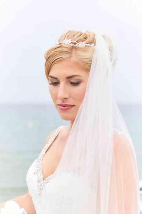 Hochzeitsfotografie Pure Emotion Wedding Hauke Lauth Portrait einer Braut mit Schleier am Strand